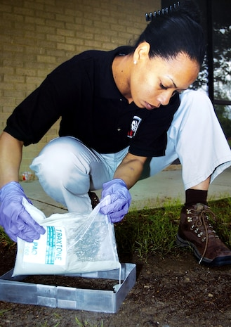Special Agent Tam Reed carefully pours a dental solution into a mock footprint to get a three-dimensional impression of the shoe sole. The technique, called casting, results in a hardened mold in about 45 minutes. It can also be used to take car tire impressions as well as two-dimensional impressions, such as footprints on slick floor surfaces or fingerprints on window sills. Agent Reed is a forensic science consultant with the Air Force Office of Special Investigations' 33rd Field Investigations Squadron. (U.S. Air Force photo/Bobby Jones)