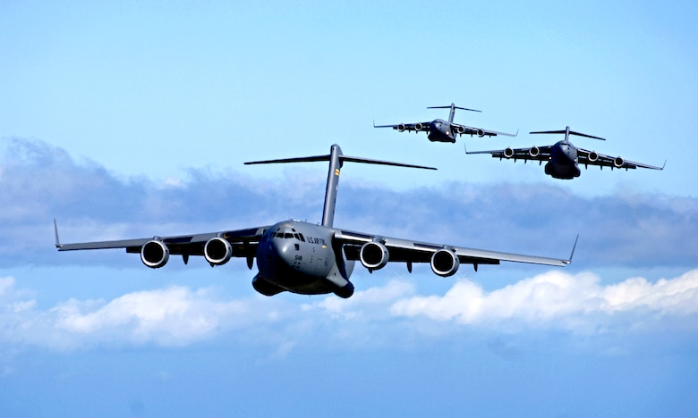 C-17 Globemaster IIIs from the 535th Airlift Squadron, Hickam Air Force Base, Hawaii participate in a airdrop training mission May 16, 2006. The 535th AS is conducting the training to provide multi-element training for the pilots and maintain aircrew proficiency. (U.S. Air Force photo/Tech. Sgt. Shane A. Cuomo)