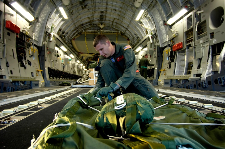 Tech. Sgt. Ken Bragg inspects and prepares an extraction chute on his C-17 Globemaster III for an upcoming airdrop training mission May 16, 2006, at Hickam Air Force Base, Hawaii. Sergeant Bragg is a loadmaster from the 535th Airlift Squadron. The training provides multi-element training for the pilots enables users to get larger amounts of equipment in a short period of time and maintains aircrew proficiency. (U.S. Air Force photo/Tech. Sgt. Shane A. Cuomo)