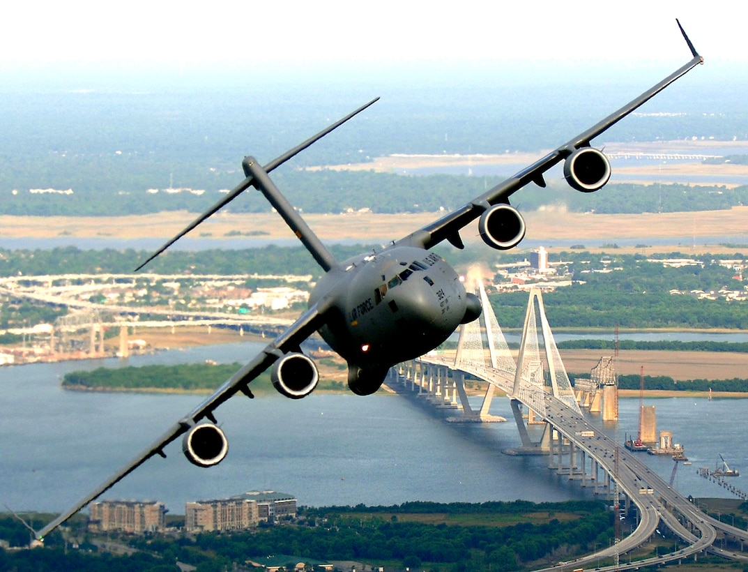 A U.S. Air Force C-17 from Joint Base Charleston banks over the Arthur J. Ravenel Bridge above downtown Charleston during a training mission, May 16, 2006. (U.S. Air Force photo by Tech. Sgt. Russell E. Cooley IV)