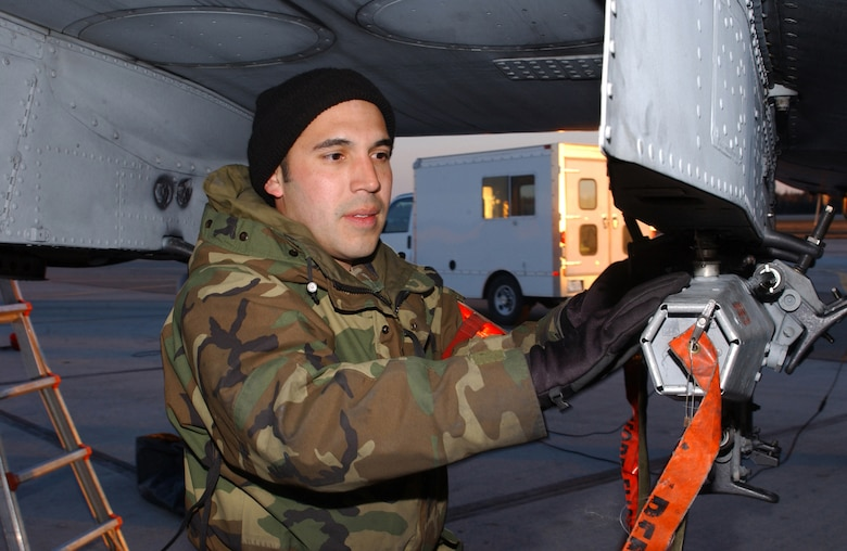 """EIELSON AIR FORCE BASE, Alaska - Staff Sergeant Johnny Rodriquez, weapons loader with the 75th Aircraft Maintenance Unit, Pope Air Force Base, N.C., performs a weapons checks on the 75th Fighter Squadron's A-10 """"Warthog"""" as part of  Red Flag - Alaska taking place here until May 5th.  (US Air Force Photo by TSgt Julie Avey)"""