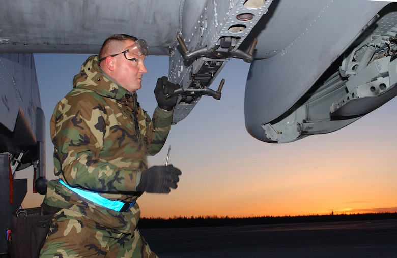 """EIELSON AIR FORCE BASE, Alaska - Staff Sergeant Brian Booze a Crew Chief  from the 75th Fighter Squadron, Aircraft Mainteance Unit, Pope Air Force Base, North Carolina is taking part in Red Flag - Alaska .  Seargent Booze is prepaing an A-10 """"Warthog"""" for the next flying mission over the Pacific Alaskan Range Complex. (US Air Force Photo by TSgt Julie Avey)"""