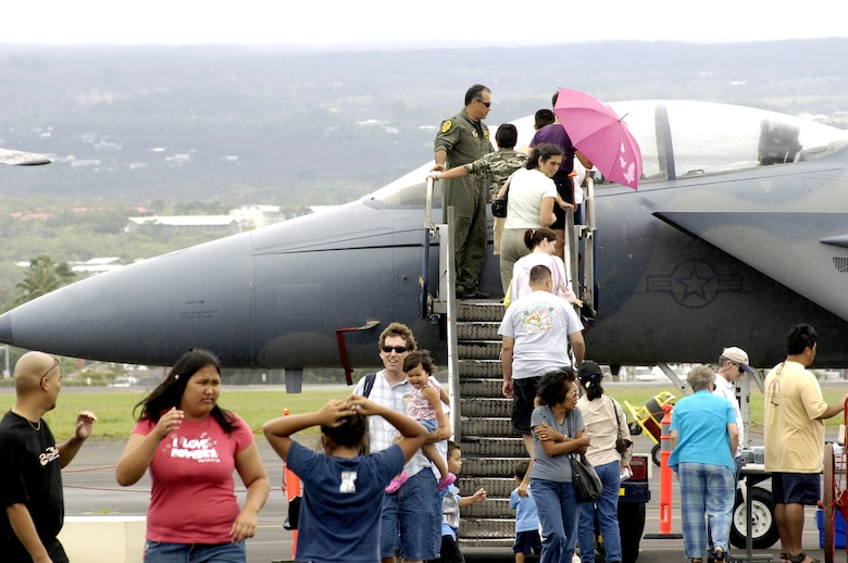 Visitors line up to view the cockpit of an F-15E Strike Eagle on Saturday, May 20, 2006, during an Armed Forces Day air show at Hilo International Airport, Hawaii.  The Hawaii Air National Guard hosted the show to give the public a chance to view various aircraft stationed in Hawaii and to generate public interest in the military. (U.S. Air Force photo/Tech. Sgt. Shane A. Cuomo)