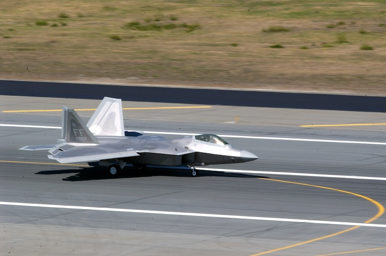 An F-22 Raptor taxis after landing at Elmendorf Air Force Base, Alaska, on Tuesday, May 23, 2006. Raptors from the 27th Fighter Squadron at Langley AFB, Va., are supporting Exercise Northern Edge 2006. The Air Force has selected Elmendorf as the home for the next operational F-22 squadron. The base will receive 36 Raptors, with the first jet expected in fall 2007. (U.S. Air Force photo/Staff Sgt. Dave Donovan)