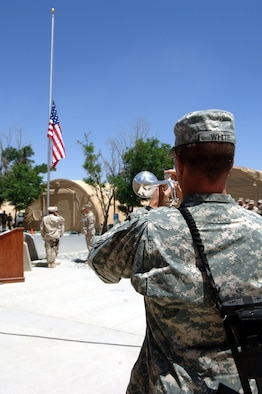 BAGRAM AIRFIELD, Afghanistan -- An Army bugler plays Taps during the closing moments of a memorialceremony held here May 13 by the 455th Expeditionary Security Forces Squadron in remembrance of 18 Airmen who were killed trying to end the USS Mayaguez incident in 1975.  (Photo by Master Sgt. Orville Desjarlais Jr.)