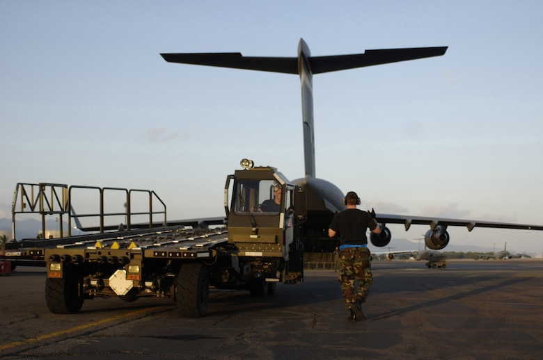 HICKAM AIR FORCE BASE, HAWAII -- Staff Sgt. Nathan Rust, an aerial port specialist assigned to the 735th Air Mobility Squadron, Hickam Air Force Base, Hawaii, backs a Halvorsen aircraft pallet loader onto a C-17 May 25.   Hickam Air Force Base sent the loaders along with two C-17s and approximately 25 personnel to assist the Australian Defense Force move personnel and equipment to Australia from the Solomon Islands in support of peace operations in East Timor after continued unrest between East Timorese military forces and breakaway groups of police and military. (U.S. Air Force Photo by Tech. Sgt. Shane Cuomo)