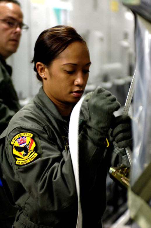 Staff Sgt. Joleen Manuia tightens a cargo strap on an equipment pallet on a C-17 Globemaster III at Royal Australian Air Force Base Townsville, Australia, on Sunday, May 28, 2006. Sergeant Manuia is a C-17 Globemaster III loadmaster with the Hawaii Air National Guard's 204th Airlift Squadron.  She is one of the Air Force crew members helping move equipment and troops from the Solomon Islands to Australia, repositioning Australian Defense Forces to support peace operations in East Timor. (U.S. Air Force photo/Tech. Sgt. Shane A. Cuomo)