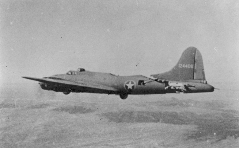 "Boeing B-17F-5-BO (S/N 41-24406) ""All American III"" of the 97th Bomb Group, 414th Bomb Squadron, in flight after a collision with an Me-109. The aircraft was able to land safely. (U.S. Air Force photo)"