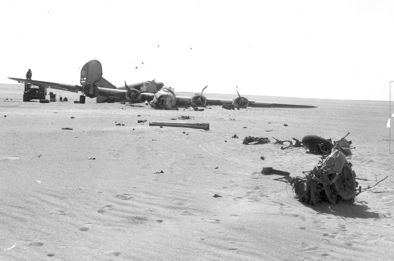 "Aircraft parts were strewn by the Consolidated B-24D ""Lady Be Good"" as it skidded to a halt amid the otherwise emptiness of the desert. (U.S. Air Force photo)"