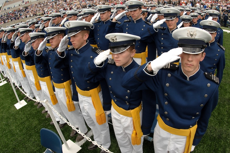 New lieutenants salute during the National Anthem at the opening of the U.S. Air Force Academy graduation ceremony in Colorado Springs, Colo., on Wednesday, May 31, 2006. The 879 graduates of the Class of 2006 incur a five-year active duty service commitment. Secretary of Defense Donald H. Rumsfeld was the guest speaker at the commencement. (U.S. Air Force photo/Joel Strayer)