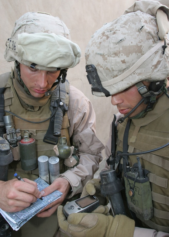 RAMADI, Iraq - U.S. Marine Corps Lance Cpl. Steven T. Gianetto and Cpl. Luis M. Perez receive their location coordinates via a Global Positioning System device recently. Lance Cpl. Gianetto and Cpl. Perez are attached to India Company, 3rd Battalion, 8th Marine Regiment. (U.S. Marine Corps photo by Lance Cpl. William L. Dubose III)