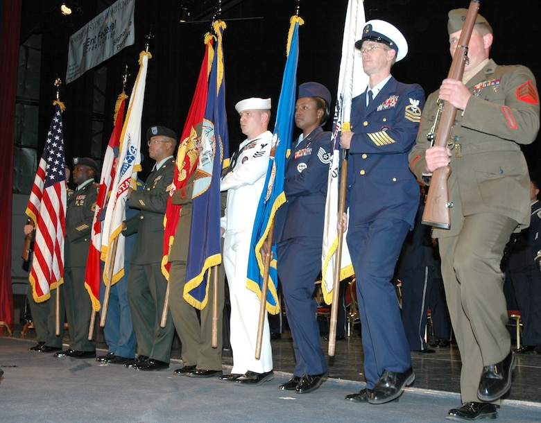 The five military services comprised the joint color guard presenting The Colors at the The Chamber's Armed Forces Day Luncheon in Colorado Springs, Colo.,  May 18.  More than 800 people from the commuunity and local military installations attended the event. (U.S. Air Force photo by Tech. Sgt. Kate Rust)
