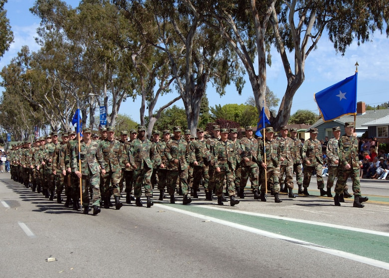 Brig. Gen. William McCasland leads the Los Angeles Air Force Base Marching Unit during the Torrance Armed Forces Day Parade. The DoD selected the City of Torrance, Calif. as one of the nationally-recognized regional sites to celebrate Armed Forces Day May 20, with dedicated military support. All five services were represented. (U.S. Air Force photo by Teri Mathis)