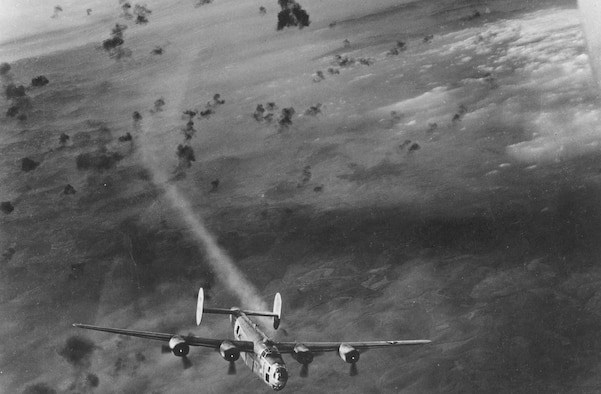 Consolidated B-24 emerges from flak area with its No. 2 engine smoking. (U.S. Air Force photo)
