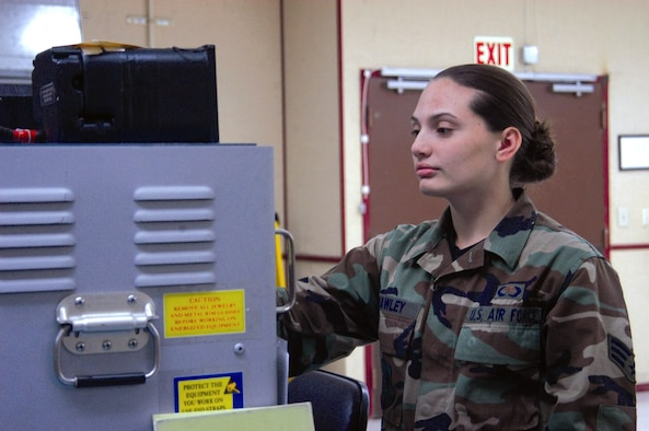 Senior Airman Sharon Howley, an integrated avionics mechanic, works with the T-38 flight director system test set. At age 19, Airman Howley is the youngest of more than 9,100 graduates earning their degrees in the October class of the Community College of the Air Force. She is also one of the youngest Airmen to earn a degree in the CCAF's 32-year history. Airman Howley is assigned to the 412th Maintenance Squadron at Edwards Air Force Base, Calif. (U.S. Air Force photo/Airman Stacy Garcia)