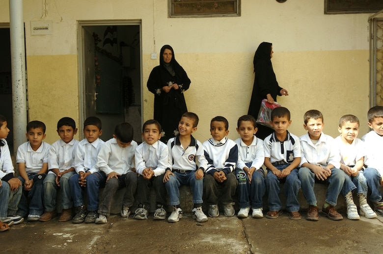 Young Iraqi students wait patiently before being given school supplies at a primary school in the Bayaa District of Baghdad, Iraq, Oct. 31. (U.S. Air Force photo/Master Sgt. Mike Buytas)