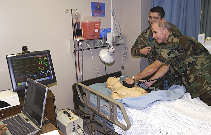 """Brig. Gen. Richard Devereaux, 82nd Training Wing commander, attempts to revive a """"patient"""" Sept. 14 during an orientation visit to the 882nd Training Group. The general visited each squadron, practicing medicine along the way. (U.S. Air Force photo/Harry Tonemah)"""