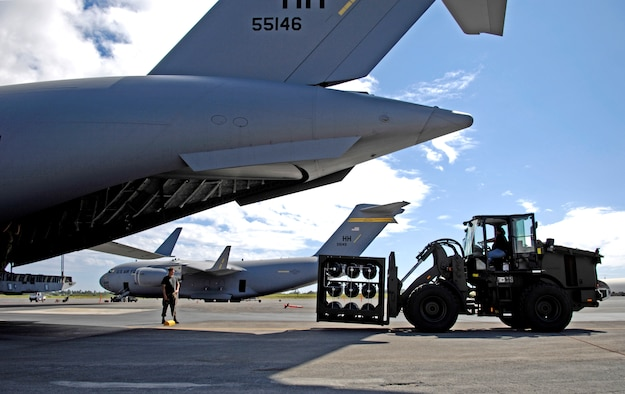 The HydraFLX System is brought up to the back end of a C-17 Globemaster III to demonstrate its mobile capability at Hickam Air Force Base, Hawaii Oct. 18, 2006. The HydraFLX System is being tested by the Air Force as an alternate energy source. It will generate ultra-pure H2 (hydrogen) from water in a flexible pressure management process for fueling buses, tow-tractors, vans, sedans and ground support equipment. The system can also be deployed anywhere and operate in hostile theaters without infrastructure or pipelines.
