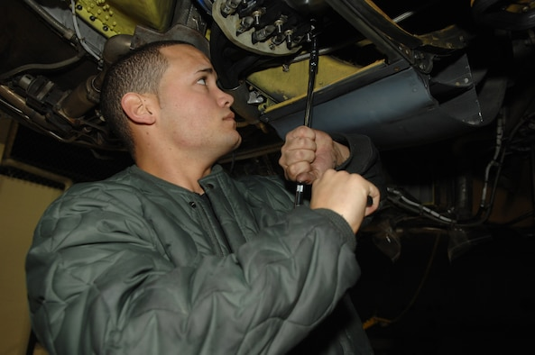 MINOT AIR FORCE BASE, N.D. -- Airman 1st Class Ismael Rodriguez, 5th Maintenance Squadron jet engine mechanic, unfastens bolts to a generator connected to the engine of a B-52H Stratofortress here Tuesday during a phase inspection. The B-52 usually goes through twelve days of repairs during the inspection before its ready to fly again.(U.S. Air Force photo by A1C Christopher Boitz)