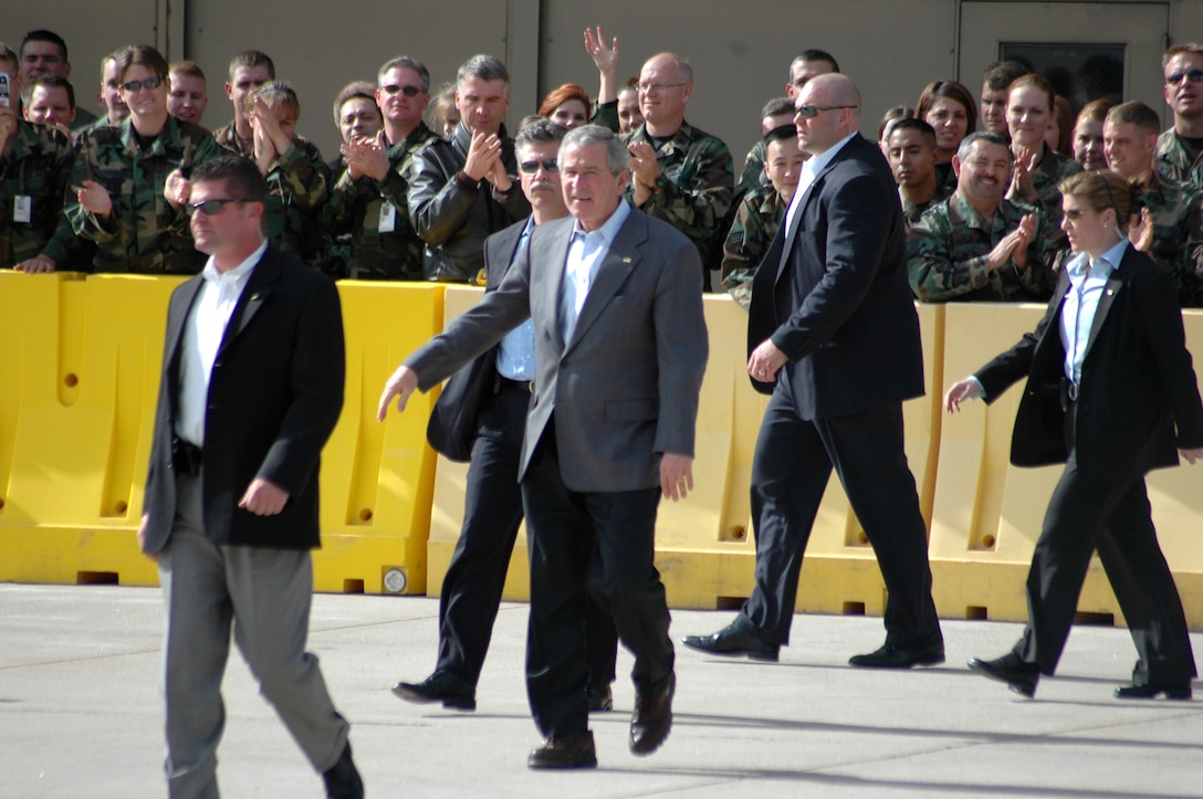 President George W. Bush walks back from meeting and shaking hands with about 50 Colorado Air National Guard members outside of Hangar 909 before he flew out of Buckley Air Force Base, Colo., Nov. 4. The president was in Denver for a political rally. (U.S. Air Force photo/Staff Sgt. Sanjay Allen)