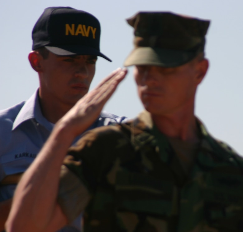 Senior Chief Petty Officer Benno Lederer of the Navy Seabee detachment here renders a salute while passing the reviewing stand during the Armed Forces Day Parade May 19. It was the first parade on Sheppard's new parade field. Also pictured is Seaman Recruit Vincent Karkau.   (U.S. Air Force photo/John Ingle).