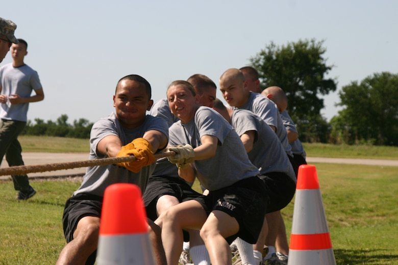 Sergio Franco, along with members of the Army Joint Warrior Competition team, take part in the tug-of-war event Saturday. The Army team went to the final round in the event, beating out the the 363rd Training Squadron to get there. In the final round the Army team fought hard, but the 383rd TRS won in the tug-of-war and took the trophy home for the Joint Warrior Competition.  (U.S. Air Force photo/Airman Jacob Corbin).