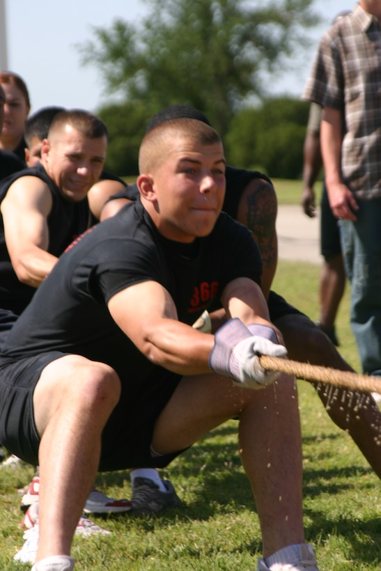 Justin Bourg pulls at the front of the rope with his teammates from the 366th Training Squadron during the tug-of-war event, Saturday at the Joint Warrior Competition. The competition was held as part of Armed Forces Week celebrations here at Sheppard.  (U.S. Air Force photo/Airman Jacob Corbin).