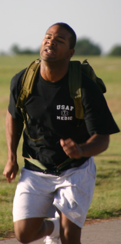 Marcus Pender from the 383rd Training Squadron participates in the rucksack relay Saturday. Pender, along with other participants, ran the relay carrying a rucksack filled with 30 pounds of sand. (U.S. Air Force photo/Airman Jacob Corbin).