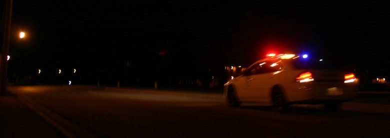 While base residents are asleep in their beds, the 82nd Security Forces Squadron is out ensuring their safety. Here, an 82nd SFS patrol car races to an emergency on base. (U.S. Air Force photo/Robert Fox)