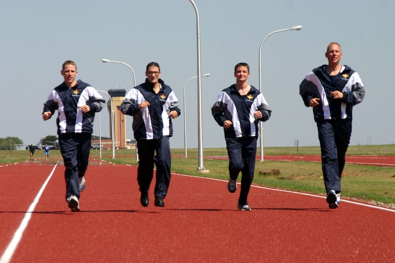 Dave Max, Derek Rowe, Randy Lund and Mark Roberts test out their Air Education and Training Command marathon team uniforms prior to leaving for the 10th annual Air Force marathon Saturday at Wright-Patterson Air Force Base, Ohio. (U.S. Air Force photo/Airman Jacob Corbin)