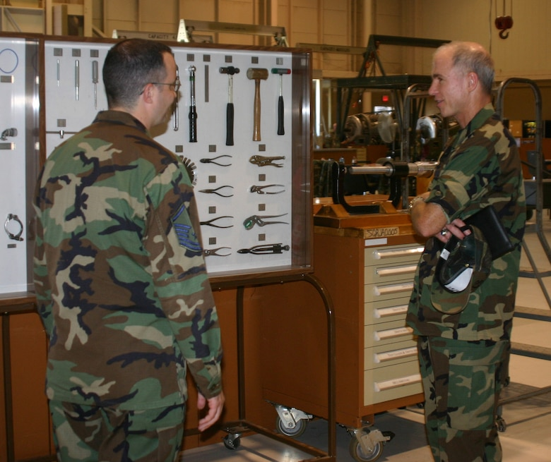 Master Sgt. David Meany tells Brig. Gen. Richard Devereaux, 82nd Training Wing commander, how the 361st Training Squadron displays tools Airmen will use in the field. (U.S. Air Force photo/John Ingle)