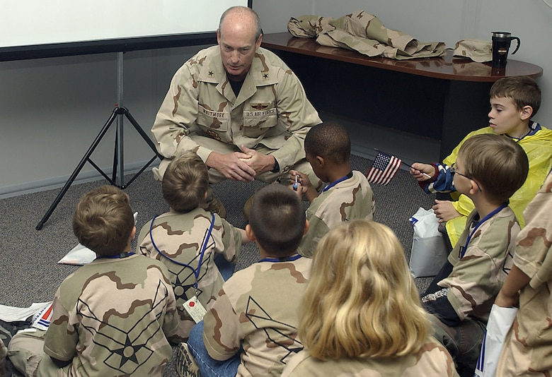 Brig. Gen. James Whitmore, 82nd Training Wing commander, briefs personnel – a.k.a. dependent children of Team Sheppard members – before they deploy to Camp Liberty at an unknown location. (U.S. Air Force photo/Mike Litteken).
