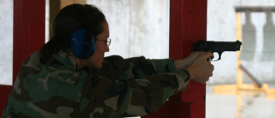 Staff Sgt. Wendi Zook, an individual mobilization augmentee with the 82nd Security Forces Squadron, uses a post for stability during firing range practice April 28. (U.S. Air Force photo/Airman Jacob Corbin).