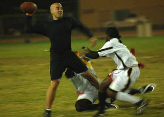 INCIRLIK AIR BASE, Turkey-- Airman First Class Nolan Palazolla,  39th Security Forces Squadron quarterback, keeps his cool in the pocket as the 39th Logistical Readiness Squadron's defense brings pressure during Inramural flag football playoff action Nov. 7.  SFS came out on top 20-19.  (U. S. Air Force photo by Airman First Class Nathan W. Lipscomb)