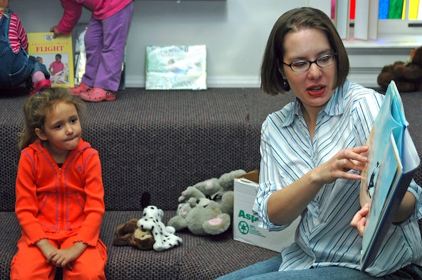 Katelyn Mann listens to a story about Orville and Wilbur Wright during storytime in the Warren library Nov. 3. Children's Story Hour is held every Friday at 11 a.m. in the base library and includes reading and other activities for children.