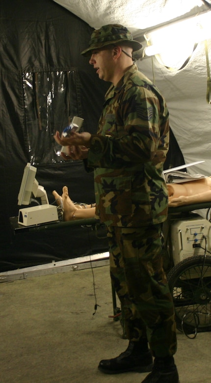 Tech. Sgt. Brian Westington of the 381st Training Squadron instructs medical readiness students on the use of a field blood gas analyzer. (U.S. Air Force photo/Robert Fox).