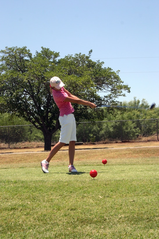 Elizabeth Stone, 15 years old, tees off at her first hole of the Texas-Oklahoma Junior Golf Tournament Monday. (U.S. Air Force photo/Airman Jacob Corbin).