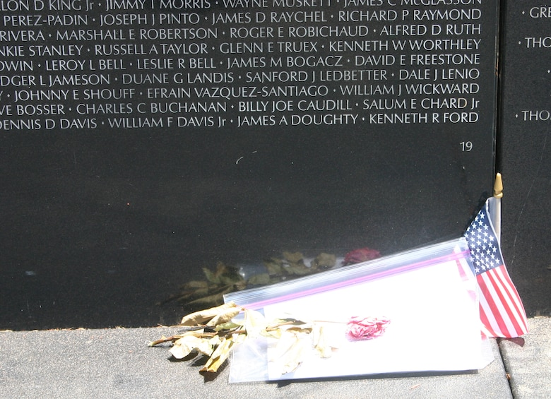 A single rose lays at the base of section 19 of the Vietnam Moving Wall as a tribute to fallen military personnel. The Moving Wall traveled to Wichita Falls June 13 and was open to the public June 16 through Sunday. (U.S. Air Force photo/Senior Airman Tonnette Thompson).