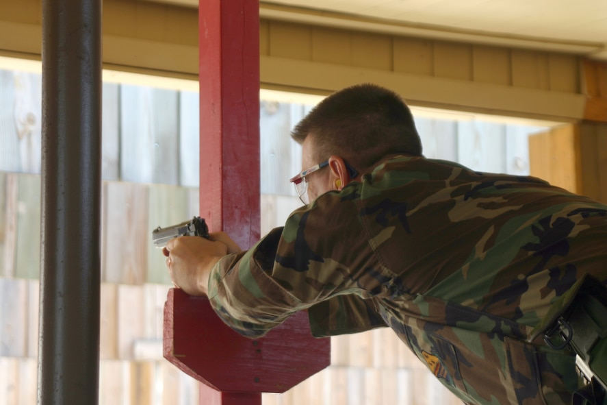 82nd Mission Support Group commander Col. Steven McKay shoots an M9 pistol to qualify. Seven of Sheppard's commanders shot for qualification Wednesday morning. Colonel McKay shot 35 out of 45. (U.S. Air Force photo/Airman Jacob Corbin).