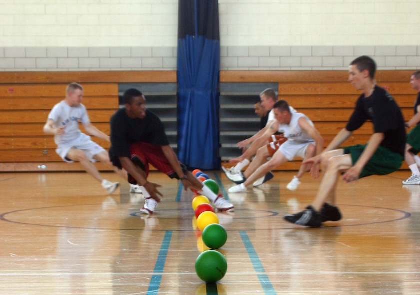 Participants in the FITS program dodgeball game race for balls in the center of the court while attemtping to avoid their opponents throws. (U.S. Air Force photo/Airman Jacob Corbin).