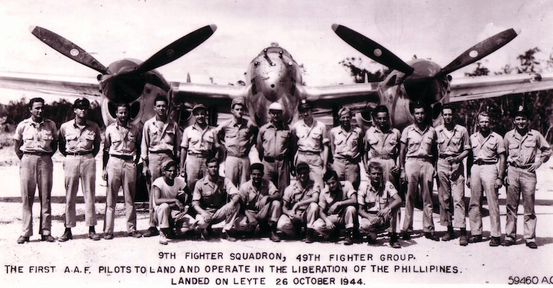 Founding members of the 9th Fighter Squadron, 49th Fighter Group, stand in front of a P-38 Lightning in the Philippines on Oct. 26, 1944. They were the first Army Air Force pilots to land there in support of the Liberation of the Philippines.