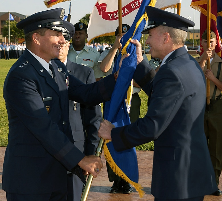 Brig. Gen. Richard Devereaux takes the flag of the 82nd Training Wing Aug. 25 from Maj. Gen. Michael Gould, 2nd Air Force commander. General Devereaux took command from Brig. Gen. James Whitmore during the early morning ceremony. (U.S. Air Force photo/Sandy Wassenmiller)