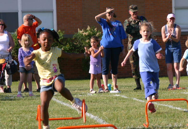 Heaven Terrel and Cameryn Norris, kindergarten students at Sheppard Elementary, participate in the hurdles event Friday. (U.S. Air Force photo/Airman Jacob Corbin).