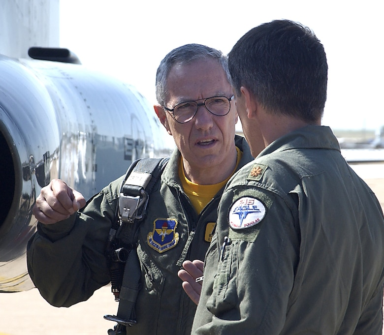 Lt. Gen. Gian Piero Ristori, Italian deputy commander of the School of the Air Force, visits with Maj. Rick Folkening of the 90th Flying Training Squadron May 19 before the general's flight in a T-38C Talon. (U.S. Air Force photo/Mike Litekken).