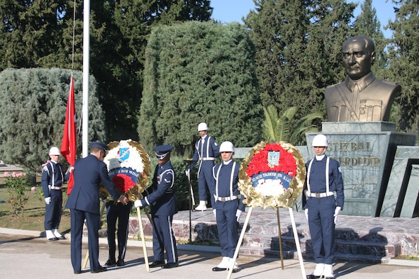 INCIRLIK AIR BASE, Turkey -- Members of the 39th Air Base Wing honor guard prepare a memorial wreath as members of the 10th Tanker Air Force honor guard stand at attention during a joint-Turkish and U.S. Air Force formation commemorating Mustafa Kemal Ataturk Nov. 10. This year marks the 68th anniversary of Ataturk's death.  Ataturk, the founder and first president of the modern Republic of Turkey, set up schools, separated religious affairs from state affairs and granted women equal rights as men. (U.S. Air Force photo by Senior Airman Patrice Clarke)