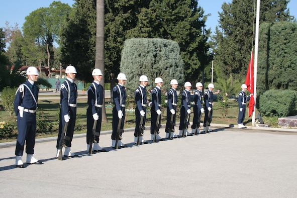 INCIRLIK AIR BASE, Turkey -- Members of the 10th Tanker Air Force honor guard prepare to rasise the Turkish flag to half mass to commemorate Mustafa Kemal Ataturk's memorial Nov. 10, in front of the 10th Tanker headquarters building.  This year marks the 68th anniversary of Ataturk's death.  Ataturk, the founder and first president of the modern Republic of Turkey, set up schools, separated religious affairs from state affairs and granted women equal rights as men. (U.S. Air Force photo by Senior Airman Patrice Clarke)