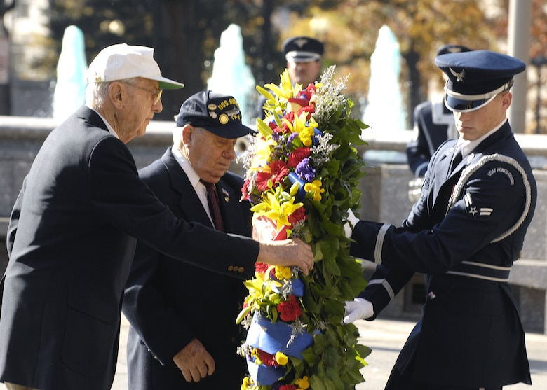 Retired Maj. Gen. David Jones and Philip Antoniello lay a wreath in honor of the USS Hornet at the Navy Memorial in Washington Nov. 9. On April 18, 1942, the Doolittle Raiders, led by then Lt. Col. Jimmy Doolittle, became the first to bombard Japan following the attack on Pearl Harbor. The Doolittle Raiders have celebrated their victory for the past 64 years. (U.S. Air Force photo/Airman 1st Class Rusti Caraker)