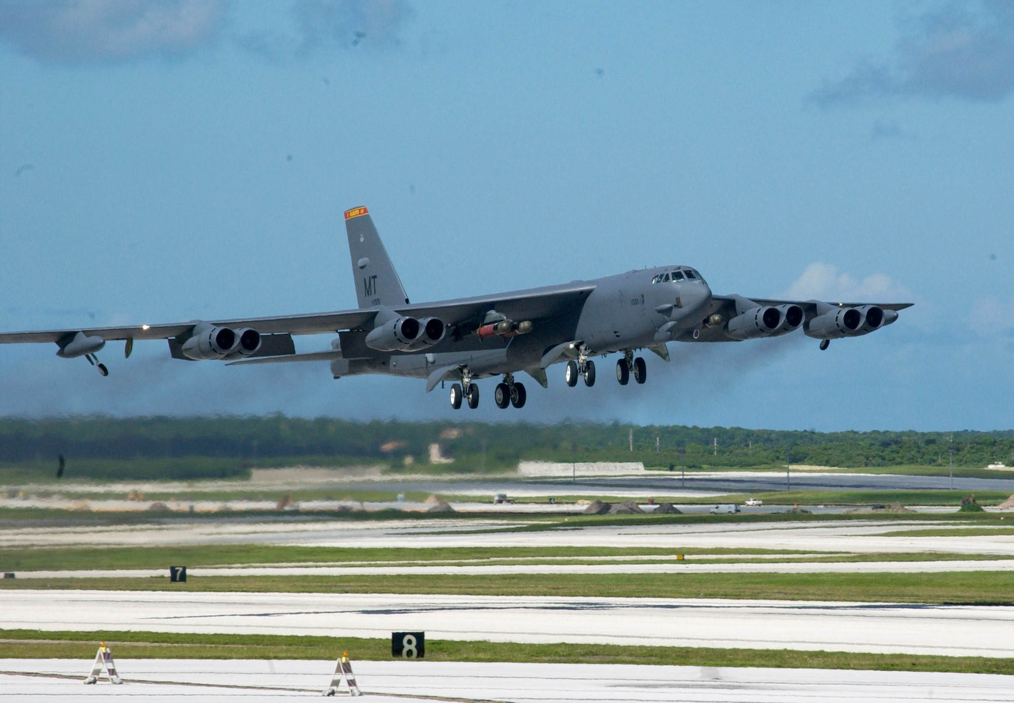 A B-52 Stratofortress takes off from Andersen Air Force Base, Guam, Nov. 3 armed with four Mk 56 mines. This sortie was the 10th and final mission of a week-long joint sea mine-laying exercise with the Navy. The B-52s dropped a total of 96 inert mines on two practice mine fields that were each three miles long and a mile wide. (U.S. Air Force photo/Staff Sgt. Eric Petosky)
