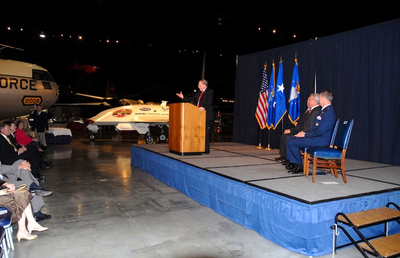 The Boeing X-45A unmanned combat air vehicle was officially inducted into the National Museum of the United States Air Force collection during a special ceremony on Nov. 13, 2006. Here, retired Maj. Gen. Charles D. Metcalf, museum director, addresses the audience. (U.S. Air Force photo)