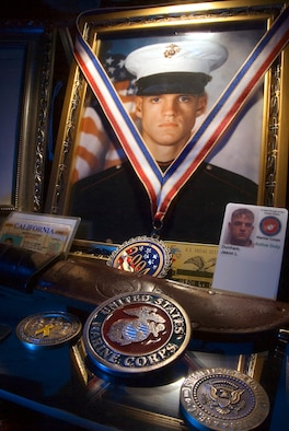 SCIO, N.Y. -- The family of Marine Cpl. Jason Dunham has keepsakes displayed in their living room and encased in a wooden, six-foot tall cabinet. President George W. Bush announced Nov. 10 that Corporal Dunham would receive a Congressional Medal of Honor for actions that saved the lives of two fellow Marines in April 2004. (U.S. Marine Corps photo/Staff Sgt. Scott Dunn)